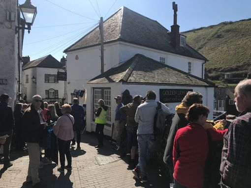 Crowds are gathered and vehicles have parked on the slipway (Image: Simon Heester)